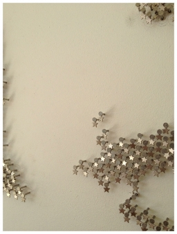 DETAIL – 2013 Metal star charms on stainless steel nails on white lacquered panel