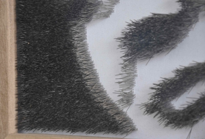 "CLO IN PINS DETAIL OF BACK– 2009 - Stainless steel straight pins on stretched canvas in caoba frame – 15"" x 15"" x 2¼"""